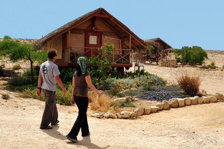 NEGEV, ISR - APR 07:Happy couple in a desert lodge on April 07 2011.The Negev covers more than half of Israel, over some 13,000 km² (4,700 sq mi) or at least 55% of the country's land area.