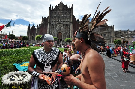 mexican folklore: MEXICO CITY - FEB 23 2010: Ancient indian Aztec empire folklore at the Zocalo Square in Mexico City, Mexico.It has been a major gathering place for Mexican people  since Aztec times