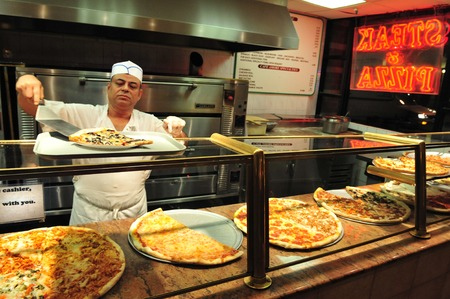 new york: NY - OCT 11: Pizzeria restaurant on October11 2009 in Manhattan New York. About 5,000,000 pounds of Pizza is consumed in the Untied States alone in one day. Editorial
