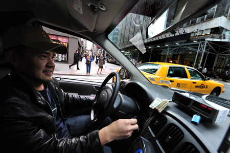 taxicabs: NY - OCT 14: Yellow taxicab driver on October 09 2009 in Manhattan New York.Over a million people ride a cab every day