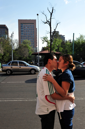 smooch: MEXICO CITY - FEB 25: Mexican couple Kissing in public on February 25 2010 in Mexico City, Mexico.Some cultures and religions frown upon public displays of affection.