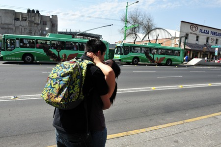 smooch: MEXICO CITY - FEB 24: Mexican couple Kissing in public on February 24 2010 in Mexico City, Mexico.