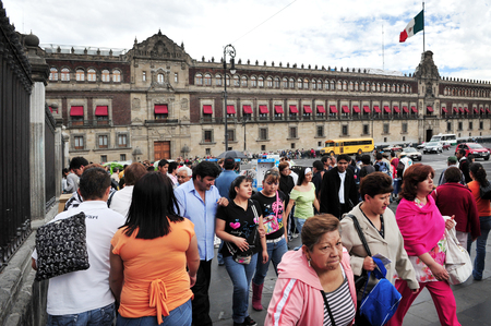 MEXICO CITY - FEB 23 2010:Visitors outside the Mexico National Palace.Its a famous landmark and one of the oldest buildings in Mexico City, Mexico. Editorial