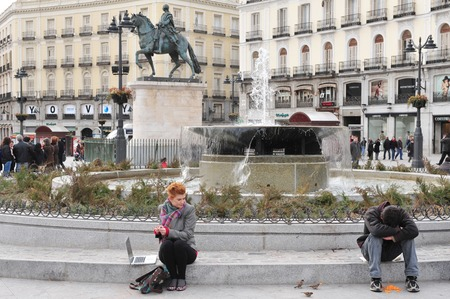 unemployment rate: MADRID - MAR 02:Beggar (R) in Plaza del Sol on March 02 2010 in Madrid, Spain.Today, 25% of Spanish workers are unemployed and a growing number of them cant afford to buy enough food to live.
