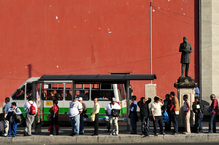 MEXICO CITY-FEB 25:Line of Mexican people in public transportation station in Mexico City on February 25 2010.Its the second busiest publicly owned transit system in North America after New York City
