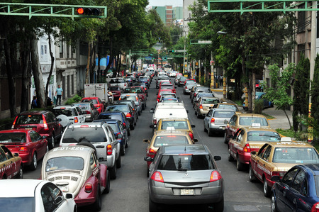 MEXICO CITY - FEB 24 2010:Traffic congestion in Mexico City.In 2012, there were 23,550,000 registered motor vehicles in Mexico. It is estimated that by 2018 there will be more than 35,495,000 vehicles in Mexico. Editorial