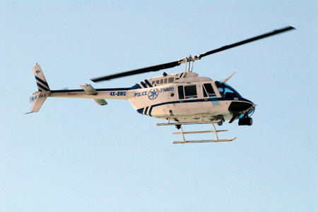pursuits: TEL AVIV - JAN 01:Israeli police helicopter on air patrol on Jan 01 2010.It commonly use for traffic control, ground support, search and rescue, public events and high-speed car pursuits. Editorial
