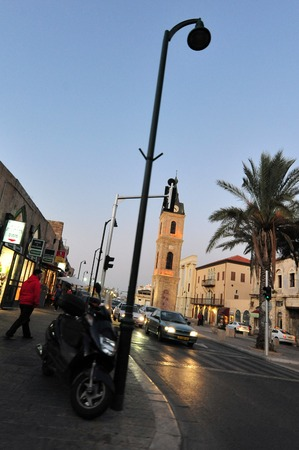 yaffo: JAFFA, ISR - NOV 16:The famous Clock Tower in ancient Jaffa on Nov 16 2009.In May 14, 1948 when the state of Israel was proclaimed the Arabs in Jaffa were joined with Jews in a religiously mixed city.