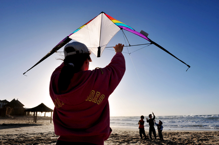 ashdod: ASHDOD - DECEMBER 19:People flying a kite on the beach on December 19 2009 in Ashdod, Israel. Kite flying is one of the fastest growing sports in the wo