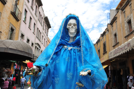 eligion: MEXICO CITY - FEB 23: Skeleton of Maria in the streets of Mexico City, Mexico on February 23 2010 .The Catholic Church is the worlds largest Christian church, and its largest religious grouping.