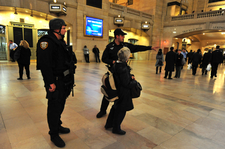 counterterrorism: NY - OCT 14:US Anti Terror and  Counter-terrorism Unit guards at the Grand Central Station Manhattan on October 14 2009 in Manhattan New York, USA.Grand Central Terminal turns 100 in 2013 Editorial