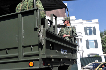 decades: MEXICO CITY - FEB 24:Mexican soldiers on a military truck on February 24 2010 in Mexico City, Mexico.In recent decades, Mexico considers itself a potential target for international terrorism.