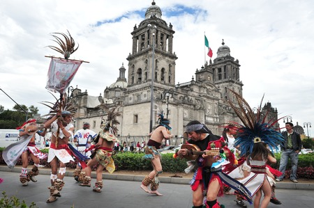 the capital city: MEXICO CITY - FEB 23: Ancient indian folklore outside Catedral Metropolitana on February 23 2010 in Mexico City, Mexico. Its the oldest and largest cathedral in all of Latin America.
