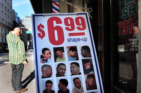 age 60: NY - OCT 11: A bald man outside a barber shop on October 11 2009 in Manhattan New York.40 of men have noticeable hair loss by age 35, 65 by age 60, and 80 by age 80. Editorial