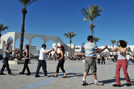 ashdod: ASHDOD, ISR - JAN 16:Ashdod residents enjoy street dancing in Ashdod Arches Beach on January 16 2010. Ashdod is the sixth largest city in Israel with population of over 200,000 people.