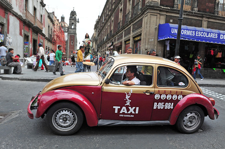 mexico: MEXICO CITY - FEB 23 2010: Classic Mexican Volkswagen Sedan taxi in Mexico City, Mexico.Mexico have 100,000 taxis,making it the biggest taxicabs fleet in the world.