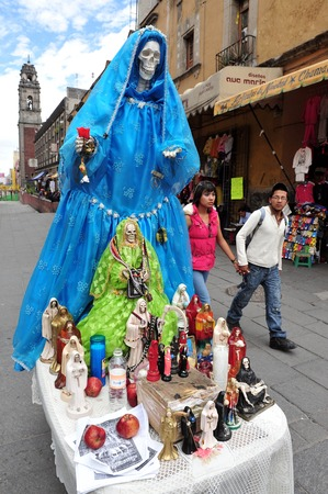 living skull: MEXICO CITY - FEB 23:Santa Muerte in Mexico city.Santa Muerte (Spanish for Our Lady of the Holy Death), is a female folk saint venerated primarily in Mexico and the Southwestern United States.