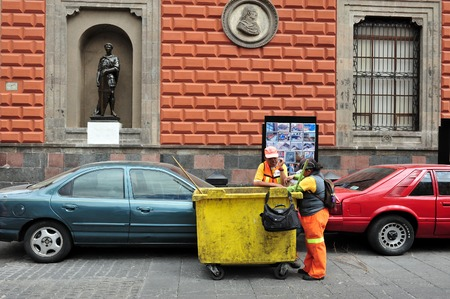 bce: MEXICO CITY - FEB 24: Mexican street sweeper on February 24 in Mexico City, Mexico. worlds first known urban sanitation systems was in India around 2600 BCE