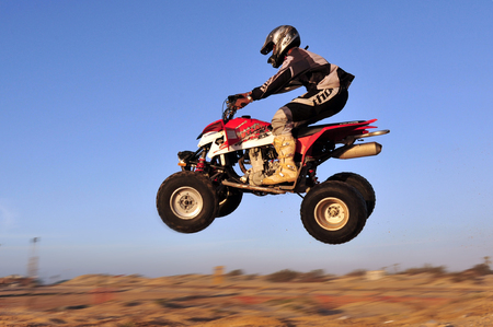ashdod: ASHDOD - DECEMBER 19:An ATV rider jumps with his Quad bike in the air on December 19 2009 in Ashdod, Israel. Off road vehicles were first made available in the early 1960s. Editorial