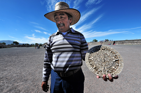 end of the world: TEOTIHUCAN - FEB 26: Mexican man selling a replica of the mayan calendar 2012 in Teotihuacan on february 26 2010 in Teotihuacan,  Mexico.The Mayan Calendar does not predict the end of the world in 2012 Editorial