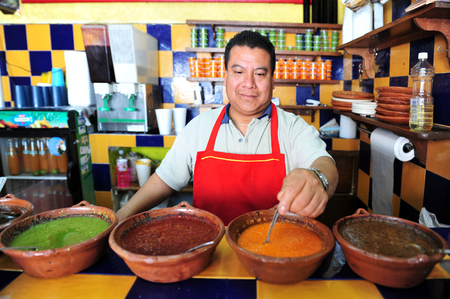 MEXICO CITY - FEB 27: Mexican  estaurant chef wait for clients on February 27 2010 in Mexico City, Mexico.Authentic Mexican food is low in fat, while being high in minerals and vitamins. Éditoriale