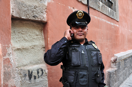 police body: MEXICO CITY - FEB 23:Federal police officers on duty on February 23 2010 in Mexico City, Mexico.The Federal police commission to ensure peace and public order and to fight the threat of drug cartels.
