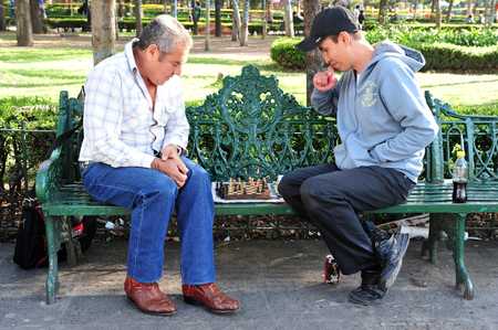 play popular: MEXICO CITY - FEB 25: Two Mexican men play chess in the park on February 25 2010 in Mexico City, Mexico.Its one of the worlds most popular games, played by millions of people all over the world.