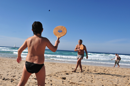 ashdod: ASHDOD ,ISR -  JAN 16:Israeli men play Matkot on Jan16 2010.Its a popular paddle ball game in Israel similar to beach tennis, often referred to as the countrys national sport