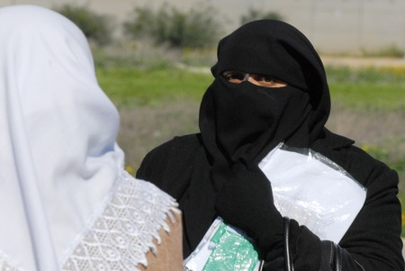 burqa: EREZ CROSSING, ISR - Muslim woman covered in burqa on Feb 11 2010.In some European countries Its illegal to wear a face-covering veil in public places such as:street, shops and public transportation.