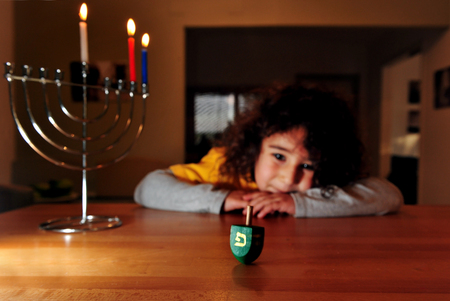 chanukkah: Jewish girl plays with dreidel during the Jewish holiday of Hanukkah. Hanukkah or Chanukah, Chanukkah, or Chanuka, also known as the Festival of Lights, is an eight-day Jewish holiday. Hanukkah is observed for eight nights and days.