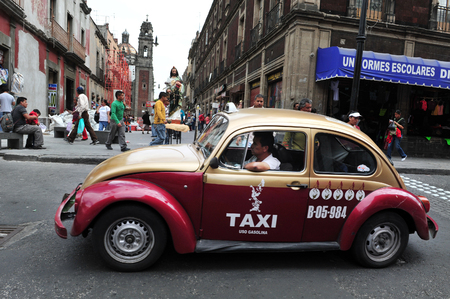 taxicabs: MEXICO CITY - FEB 23: Classic Mexican Volkswagen Sedán taxi on February 23 2010 in Mexico City, Mexico.Mexico have 100,000 taxis,making it the biggest taxicabs fleet in the world.