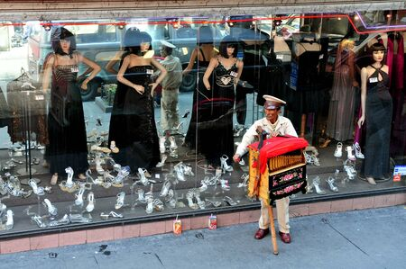 invented: MEXICO CITY - FEB 24:Mexican man play music from a music box in Mexico City, Mexico.the first music box was invented in 1796 in Switzerland Editorial