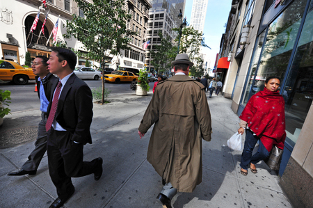 spoken: NY - OCT 14:People of different cultures share a single sidewalk in Manhattan New York on October 14 2009.As many as 800 languages are spoken in New York, making it the most linguistically diverse city in the world.