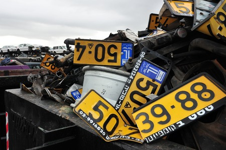 pile reuse engine: ASHDOD, ISR - JAN 04:Old vehicle registration plates during Scrappage program on Jan 04 2010.Its an government budget program to remove inefficient, high emissions vehicles from the road for safety. Editorial