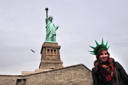enlightening: NY - OCT 12:Woman visit at the Statue of liberty on October 12 2009 in Manhattan, New York.The Statue is a universal symbol of freedom.