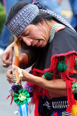 civilizations: MEXICO CITY - FEB 23 2010:Mexican man play traditional music.Modern Mexicans are a unique blend of many ancient civilizations: Olmec, Zapotec, Toltec, Maya, Aztec, Inca, African, French and Spanish