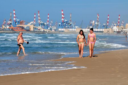 ashdod: ASHDOD, ISR - JAN 16:Ashdod residents enjoy the  sea and the  beach on January 16 2010. Ashdod is the sixth largest city in Israel with population of over 200,000 people.