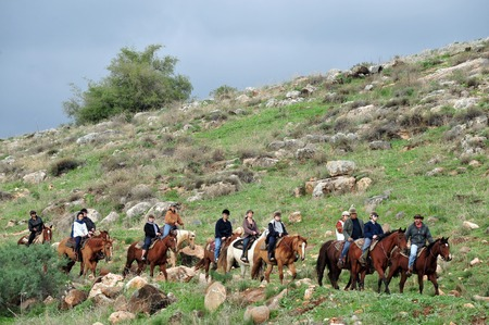 the golan heights: GOLAN HEIGHTS - DECEMBER 13:Horse riding in the Golan Heights, Israel on December 13 2009. About 18,000 Israeli settlers have moved to the Golan, which also borders Jordan, since 1967.