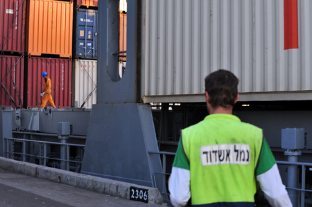 ashdod: ASHDOD - NOV 09:Docker  Port worker in Port of Ashdod on Nov 09 2009.Its one of Israels two main cargo ports and one of the few deep water ports in the world to be built on the open sea. Editorial
