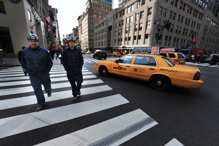 taxicabs: Yellow taxi cab, one of the public transportation in Manhattan New York, USA. Editorial