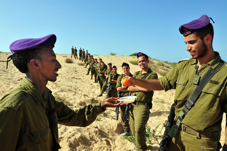 traditional custom: ZIKIM - SEPTEMBER 07: IDF soldiers are blessing on the traditional jewish custom of apple and honey to welcome Rosh Hasahanah, the Jewish New Year on September 07 2010 in Gaza border near Zikim, Israel.