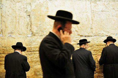JERUSALEM - JULY 20:Jewish people pray in The Cave Synagogue at the Western wall on July 20 2009 in Jerusalem, Israel. Traditionally, it is regarded as the only remnant of the Jewish Temple.