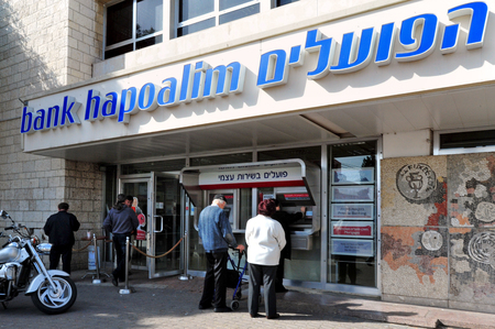 bank owned: ASHKELON, ISR - JAN 26:Bank Hapoalim branch on Jan 26 2011.Its Israels largest bank.The bank has about 14,000 employees worldwide. It is controlled by Arison Holdings, which is owned by Shari Arison