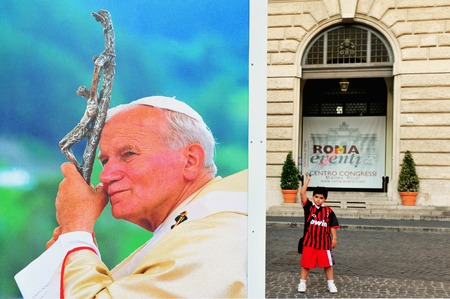 beatification: ROME - MAY 01:Giant banner bearing John Pauls portrait is unveiled over the facade in the streets of Rome during the ceremony of beatification for late pope John Paul II on May 1, 2011 at St Peters square at Vatican city in Rome Italy.