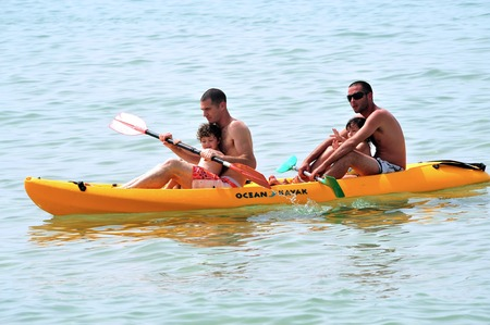 constituting: ASHKELON - APR 03:Israeli fathers and children on Kayak on Apr 03 2010.The population of children living in Israel numbered ABOUT of 2,500,000 children constituting over 30% of the general population.