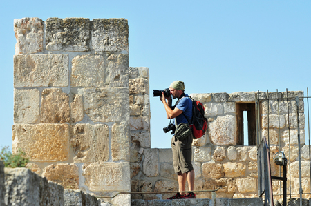 ottoman empire: JERUSALEM - NOV 05:Visitor photograph with his camera on Jerusalem city walls on November 05 2010.The walls were built during the Ottoman empire on the 15th century by Sultan Suleiman the Magnificent
