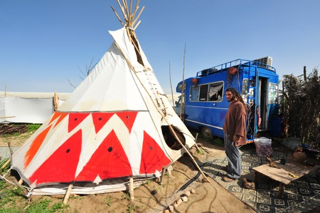 tipi: NEGEV,ISR - FEB 15:Man live in Tipi on February 15 2011.Painted  plains Indians tipis were mainly featured geometric portrayals of celestial bodies, war battles and animal designs. Editorial