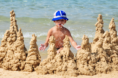 constituting: ASHKELON,ISR - OCT 16:little boy builds sand castle on Oct 16 2010.The population of children living in Israel numbered ABOUT of 2,500,000 children, constituting over 30% of the general population. Editorial
