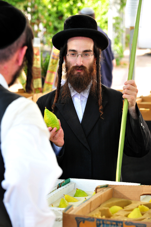 ashdod: ASHDOD - OCTOBER 12 : Jewish ultra-orthodox  purchasing blessings at a four species market for the Jewish holiday of Sukkot on October 12 2011 in Ashdod,Israel. Editorial