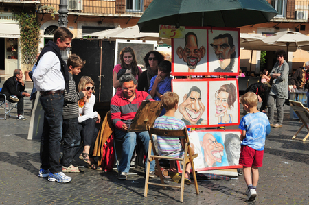1st century ad: ROME - APRIL 28:Street artist paint caricatures in Piazza Navona on April 28 2011 in Rome, Italy.Built in 1st century AD,follows the form of a stadium and the ancient Romans came there to watch games.